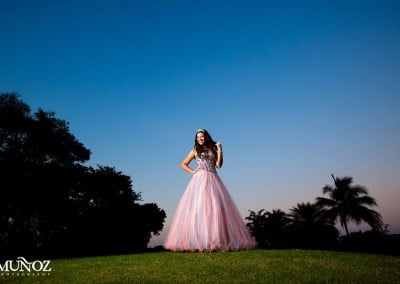 Quinceanera girl at sunset on golf course