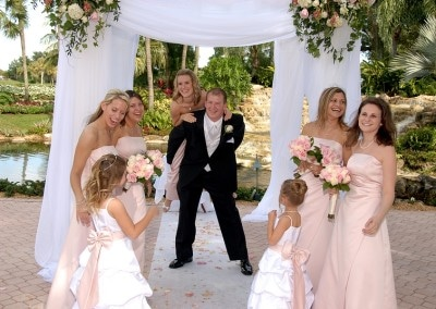 Happy bridal party with groom