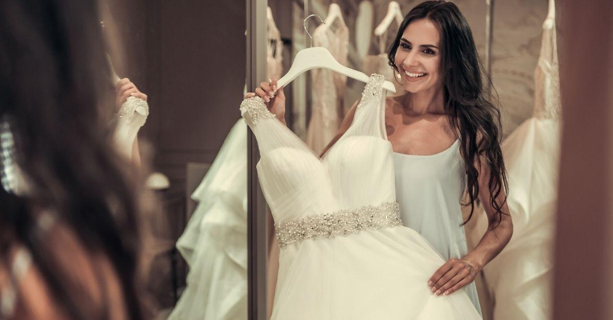 A woman trying on a wedding dress.