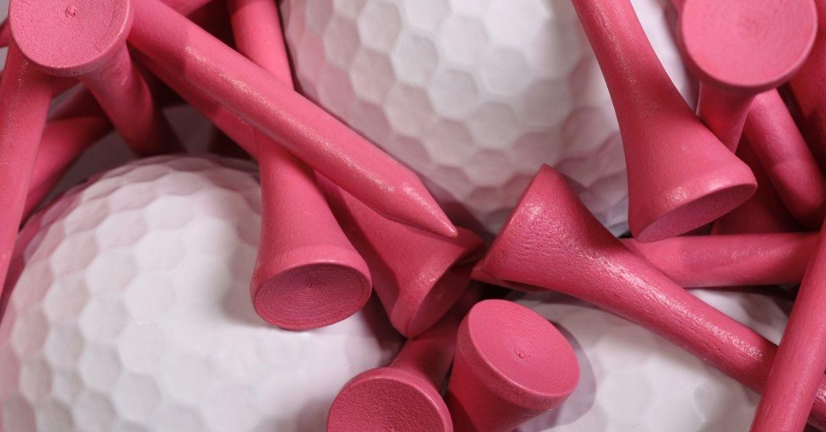 Pink golf tee and balls.